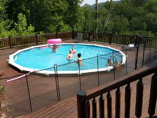 Mountain Air Retreat is a luxury Blue Ridge cabin rental with everything you like, including a swimming pool.