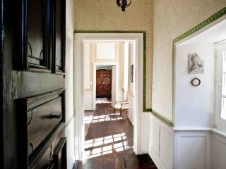The entry foyer of the Salamander shows the hand painted wall decor that is a feature of the entire