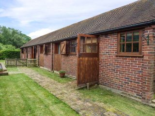 THE RACING STABLES, converted stable, single-storey, off road parking, lawned ga