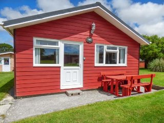72 PARKLANDS, wooden lodge, parking, patio with furniture, on holiday park, in S