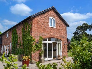 BOUGHEY'S BARN, barn conversion, en-suites, parking, garden, in Ellesmere, Ref