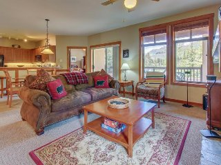Ski-in/ski-out mountain view condo with a shared pool, hot tub & game room!