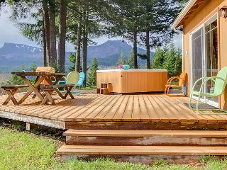 Dog-friendly w/ river & mountain views, private hot tub, firepit, & pool table!