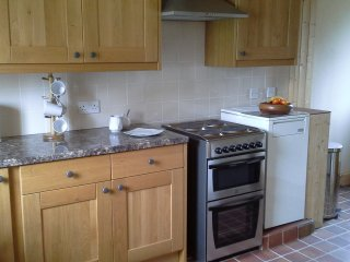 Modern newly fitted kitchen with oil central heating boiler.