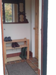 Porch, coat hooks shoes boots rack, radiator good for drying outdoor clothes shoes.