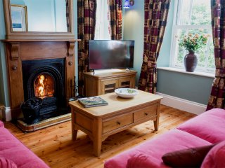 Cosy lounge with open coal fire, coal supplied