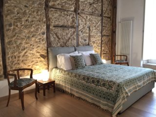 master bedroom with stone wall
