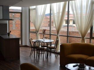 Departamento de 2 cuartos y terraza con parqueo, Cuenca