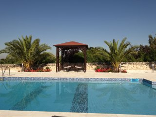 Poolside gazebo, with further alfresco dining options