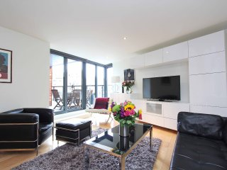 Stylish sitting room with french doors onto large terrace.  Huge 4K TV with SKY