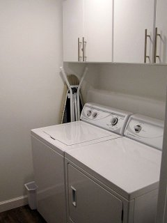 Full-size Washer and Dryer in Walk-In Closet.