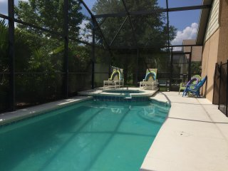 Relax by the pool complete with loungers, muskoka chairs, and hot tub/spa.