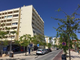 The Apartment building on the main shopping arcade above the beach,