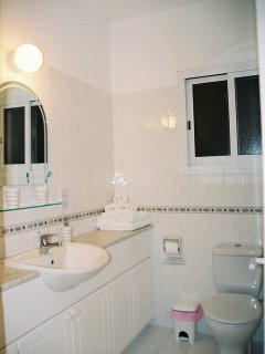 Bathroom, left view showing sink and cupboards