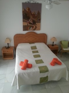 Bedroom 1: King-size bed, air-con, ceiling fan, hanging rail and other storage, access to terrace