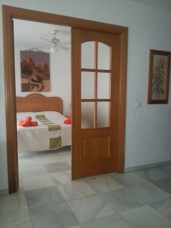 Outside Bedroom 1: wooden double doors with obscured glass