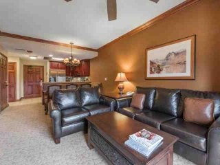 This elegantly appointed condo with picturesque views and stunning architectural detailing has been professionally decorated with sophisticated mounta