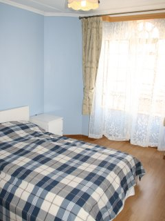 Spacious blue bedroom, wall to wall cabinets, ensuite bathroom, lots of light