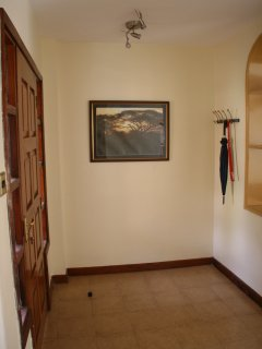 spacious open floor at entrance; wall hanger for coats, umbrellas, etc.