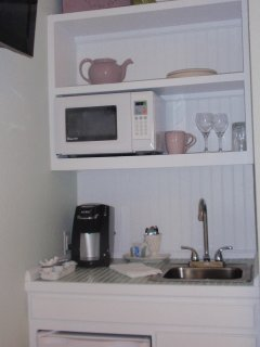 A Well Appointed Kitchenette Includes a Microwave, Refrigerator and Keureg Coffee Maker