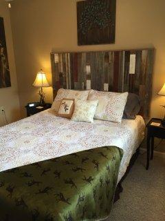 comfortable guest bedroom featuring a barn wood headboard.