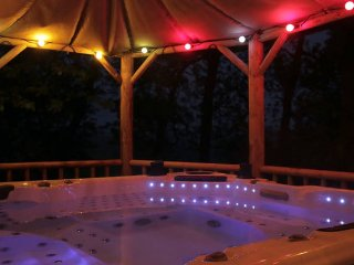 The hot tub is housed in a thatched cabana in the garden, a short distance away from the cottage