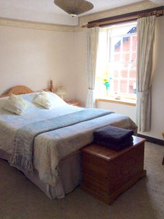 Large and characterful double bedroom, with bedside tables and  comfortable divan bed.