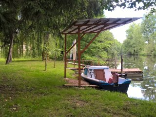 Moulin de Garabaud gite on the river with electric boat.