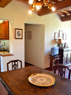 The interior furnishings and decorations are a combination of antiques and Tuscan rural pieces