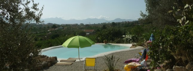 The pool and the view over Monte Pellegrino, the Gulf of Palermo and the mountains around Palermo