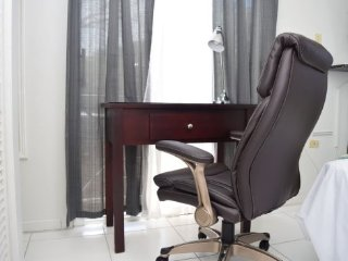 Queen Sized Air Conditioned Bedroom with office desk