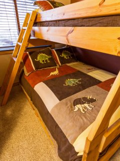 Dinosaur pillows and comforters in the bunk room!