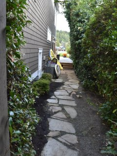 Pathway along right side of the house leading to the beach.