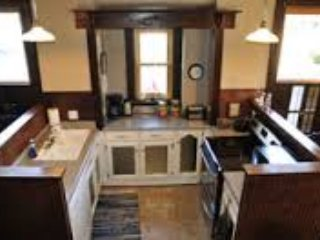 Kitchen, with all the bells and whistles.  Gold rimmed china (dishwasher friendly) in dining room.
