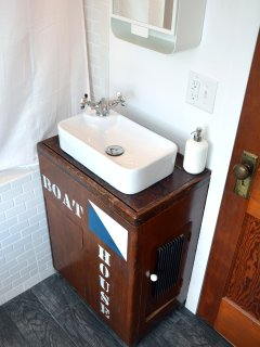 The bathroom sink is a converted boat house ice box.