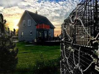 Bridge View cottage is surrounded by lobster traps, docks, and ocean vistas.