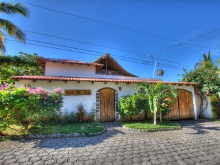Behind those doors is a beautiful paradise... Frontside / Street view of villa.