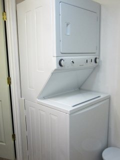 Washer and dryer in bathroom, detergent pods supplied.