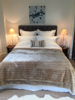 The comfortable king sized bed has quality bed linen provided.