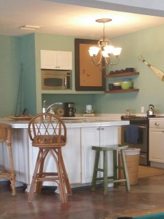 A photo of the kitchen.  Your dining table is the built-in island/breakfast nook.