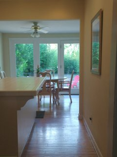 Lots of Light - Kitchen and Dining Room Look Out to Private Backyard