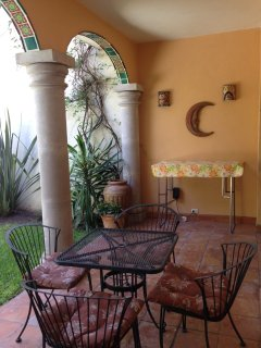 Back patio with talavera details in arches, cantera columns