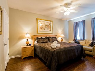 Master bedroom with King size bed and ceiling fan, 32' HD TV, walk-in closet and en-suite bathroom