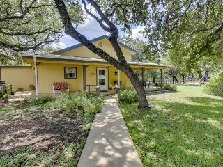 Dog-friendly home with a wrap-around porch, close to the river and town!