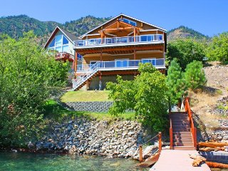 Stunning lakeside home with  private dock on Lake Chelan, spacious deck w/views!