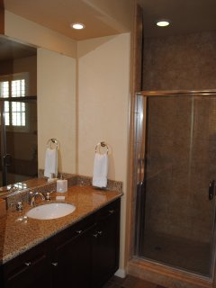Each of the bathrooms offer separate showers, soaking tubs, and toiletries.