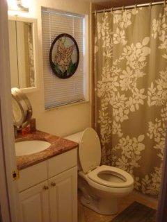 Bathroom has shower/bathtub, sink, toilet, mirror, makeup mirror