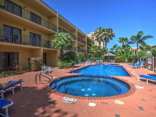 Spacious oasis near the beach w/ private balcony, shared pool & hot tub!