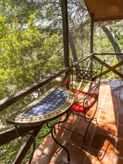 Ralaxation on your balcony of a log cabin, Andalusian and Moroccan furniture
