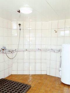 There is an inside bathroom and an outside shower room with 2 strong hot showers and extra toilet.